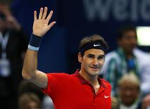 Roger Federer of Switzerland reacts after winning against Gilles Muller of Luxembourg at the Swiss Indoors ATP tennis tournament in Basel October 22, 2014.   REUTERS/Arnd Wiegmann