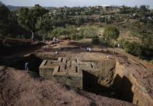 A man stands above the Bet Medhane Alem rock church during an Orthodox Good Friday celebration in Lalibela, in this May 3, 2013 file photo. REUTERS/Goran Tomasevic/File