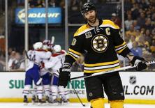 May 14, 2014; Boston, MA, USA; Boston Bruins defenseman Zdeno Chara (33) skates away as the Montreal Canadiens celebrate after Chara deflected a shot into his own goal during the third period  of Montreal's 3-1 win in game seven of the second round of the 2014 Stanley Cup Playoffs at TD Garden. Mandatory Credit: Winslow Townson-USA TODAY Sports