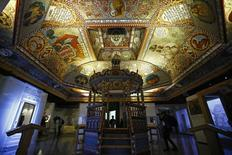 """Visitors stand under the """"Celestial Canopy"""", a reconstructed painted ceiling of a synagogue that once stood in Gwozdziec (present-day Ukraine), at the POLIN Museum of the History of Polish Jews in Warsaw October 21, 2014, one week before the official opening of the core exhibition.     REUTERS/Kacper Pempel"""