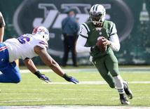 Oct 26, 2014; East Rutherford, NJ, USA; New York Jets quarterback Michael Vick (1) runs with the ball against the Buffalo Bills in the first half at MetLife Stadium. Mandatory Credit: Robert Deutsch-USA TODAY Sports