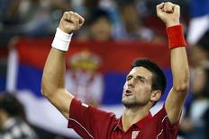 Novak Djokovic of Serbia celebrates winning his men's singles tennis match against David Ferrer of Spain at the Shanghai Masters tennis tournament in Shanghai October 10, 2014. REUTERS/Aly Song