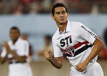 Paulo Henrique Ganso em partida pelo São Paulo contra o Kashima Antlers, no Japão, em 2013. 07/08/2013 REUTERS/Toru Hanai