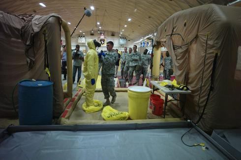 Pentagon civilians leaving Ebola zones may choose monitoring regimen