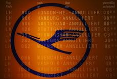 A picture taken with the multiple exposure function of the camera shows cancelled flights on a flight schedule board and the logo of German air carrier Lufthansa at the Fraport airport in Frankfurt April 2, 2014. REUTERS/Kai Pfaffenbach
