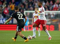 Nov 2, 2014; Harrison, NJ, USA; New York Red Bulls forward Thierry Henry (14) controls the ball against D.C. United defender Chris Korb (22) during the first half at Red Bull Arena. Mandatory Credit: Brad Penner-USA TODAY Sports