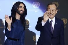 Austrian Eurovison Song Contest winner Conchita Wurst (L) meets United Nations Secretary-General Ban Ki-moon at the U.N. headquarters in Vienna November 3, 2014.   REUTERS/Heinz-Peter Bader