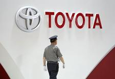 A security guard walks under the logo of Toyota Motor Corp at the company's showroom in Tokyo June 17, 2014. REUTERS/Yuya Shino