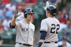 Jul 30, 2014; Arlington, TX, USA; New York Yankees left fielder Brett Gardner (11) is congratulated by center fielder Jacoby Ellsbury (22) after he hit a home run in the first inning against the Texas Rangers at Globe Life Park in Arlington. Mandatory Credit: Tim Heitman-USA TODAY Sports