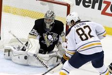 Nov 1, 2014; Pittsburgh, PA, USA; Pittsburgh Penguins goalie Marc-Andre Fleury (29) makes a save as Buffalo Sabres left wing Marcus Foligno (82) looks for a rebound during the second period at the CONSOL Energy Center. The Penguins won 5-0. Mandatory Credit: Charles LeClaire-USA TODAY Sports