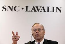Robert G. Card, president and chief executive officer of SNC-Lavalin, gestures as he addresses the media following their annual general meeting in Montreal, May 8, 2014. REUTERS/Christinne Muschi