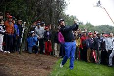 Graeme McDowell of Northern Ireland hits the ball on the ninth hole during the third round of the WGC-HSBC Champions golf tournament in Shanghai November 8, 2014. REUTERS/Aly Song