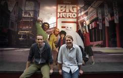 """Directors of the animated movie """"Big Hero 6"""" Don Hall (R) and Chris Williams pose for a portrait at Disney Animation Studios in Burbank, California September 29, 2014. REUTERS/Mario Anzuoni"""