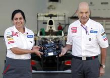 Monisha Kaltenborn (L), the new principal for the Sauber Formula One team, and outgoing team principal Peter Sauber pose at the team's garage during an announcement ceremony ahead of the South Korean F1 Grand Prix at the Korea International Circuit in Yeongam October 11, 2012.  REUTERS/Woohae Cho