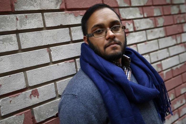 Naz Seenauth, a transgender man, poses in New York October 22, 2014.