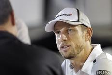 McLaren Formula One driver Jenson Button of Britain is interviewed outside his team hospitality suite at the paddock area of Singapore F1 Grand Prix in Singapore September 18, 2014.  REUTERS/Tim Chong