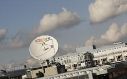 Le groupe Bertelsmann, maison mère du diffuseur RTL, a vu son excédent brut d'exploitation progresser de 1% sur les neuf premiers mois de l'année, à la faveur des premiers effets de ses acquisitions. /Photo d'archives/REUTERS/Wolfgang Rattay