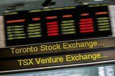 A sign board displaying Toronto Stock Exchange (TSX) stock information is seen in Toronto June 23, 2014.   REUTERS/Mark Blinch