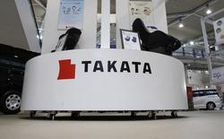 L'équipementier automobile japonais Takata est visé par une enquête pénale aux Etats-Unis en raison de ses airbags défectueux soupçonnés d'avoir joué un rôle dans la mort de cinq personnes.  /Photo prise le 5 novembre 2014/REUTERS/Toru Hanai