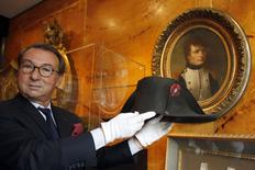 Auctioneer Jean-Pierre Osenat displays a black felt two-cornered hat belonging to French Emperor Napoleon Bonaparte at their auction house in Paris October 24, 2014. REUTERS/Charles Platiau