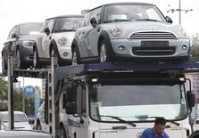 A truck driver prepares to transport BMW's Mini cars in Goyang, north of Seoul, in this June 12, 2013 file picture.    REUTERS/Lee Jae-Won/Files