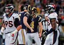 Nov 16, 2014; St. Louis, MO, USA; St. Louis Rams kicker Greg Zuerlein (4) celebrates with punter Johnny Hekker (6) after kicking a 55 yard field goal during the second half against the Denver Broncos at the Edward Jones Dome. The Rams won 22-7. Mandatory Credit: Jeff Curry-USA TODAY Sports