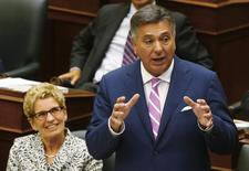 Ontario Finance Minister Charles Sousa (R) delivers the provincial budget alongside Ontario Premier Kathleen Wynne at Queens Park in Toronto, July 14, 2014. REUTERS/Mark Blinch