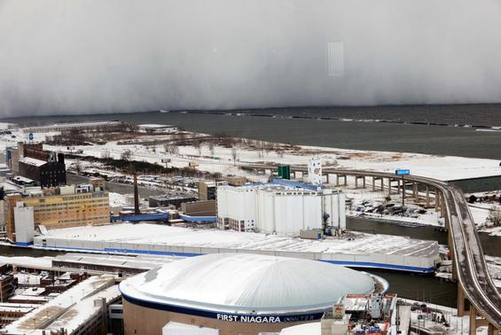 A lake-effect snow storm with freezing temperatures produces a wall of snow travelling over Lake Erie into Buffalo, New York. November 18, 2014.  REUTERS-Gary Wiepert