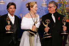 """Actress Meryl Streep (C) is joined by """"Angels in America"""" director Mike Nichols (R) and fellow cast member Al Pacino backstage at the 56th annual Primetime Emmy Awards in Los Angeles, in a September 19, 2004 file photo. REUTERS/Lucy Nicholson/files"""