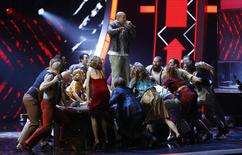 "Residente of Calle 13 performs ""El Aguante"". REUTERS/Mike Blake"