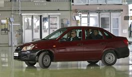 Russian Prime Minister Vladimir Putin (2nd L) drives a new Lada Granta during his visit to the AvtoVaz car plant in the southern Russian city of Tolyatti May 11, 2011. REUTERS/Alexei Nikolsky/RIA Novosti/Pool (RUSSIA - Tags: TRANSPORT) FOR EDITORIAL USE ONLY. NOT FOR SALE FOR MARKETING OR ADVERTISING CAMPAIGNS. THIS IMAGE HAS BEEN SUPPLIED BY A THIRD PARTY. IT IS DISTRIBUTED, EXACTLY AS RECEIVED BY REUTERS, AS A SERVICE TO CLIENTS - RTR2M9FL