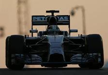 Mercedes Formula One driver Lewis Hamilton of Britain leaves the pit during the Abu Dhabi F1 Grand Prix at the Yas Marina circuit in Abu Dhabi November 23, 2014.  REUTERS/Ahmed Jadallah