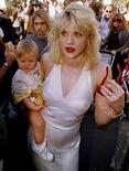 Kurt Cobain arrives with wife Courtney Love, holding their daughter Frances Bean Cobain, for the MTV Music Awards show in Los Angeles, California, in this file photo taken in September 1992. REUTERS/Fred Prouser