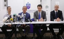 Doctor Tony Grabs (L-R), head of St Vincent's Hospital Trauma department, Cricket Australia team doctor Peter Brukner, Cricket Australia Chief Executive James Sutherland and Australian Cricketers Association chief executive Alistair Nicholson attend a news conference following the death of Australian cricketer Phillip Hughes, at St Vincent's Hospital in Sydney, November 27, 2014. Hughes died in hospital in Sydney on Thursday, two days after the international batsman was struck on the head by a ball during a domestic match.    REUTERS/Jason Reed    (AUSTRALIA - Tags: SPORT CRICKET)