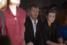 David Beckham and his son Brooklyn Beckham watch a model present a creation during the Victoria Beckham Spring/Summer 2015 collection during New York Fashion Week in the Manhattan borough of New York September 7, 2014.    REUTERS/Carlo Allegri