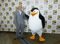 "Actor John Malkovich, who voices ""Dave"", poses with the character ""Skipper"" at a press line for the movie ""Penguins of Madagascar"" during the 2014 Comic-Con International Convention in San Diego, California July 24, 2014.  REUTERS/Mario Anzuoni"