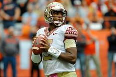Oct 11, 2014; Syracuse, NY, USA; Florida State Seminoles quarterback Jameis Winston (5) drops back to pass against the Syracuse Orange during the third quarter at the Carrier Dome.  Florida State defeated Syracuse 38-20.  Mandatory Credit: Rich Barnes-USA TODAY