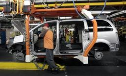 A Chrysler auto worker is seen working on a partially assembled Chrysler minivan on the assembly line during the production launch of the new 2011 Dodge Grand Caravan's and Chrysler Town & Country minivans at the Windsor Assembly Plant in Windsor, Ontario January 18, 2011.   REUTERS/Rebecca Cook