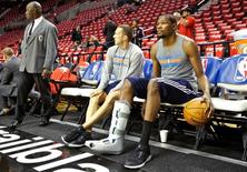 Oct 29, 2014; Portland, OR, USA; Oklahoma City Thunder forward Kevin Durant (35) dribbles a ball on the bench while wearing a boot on his leg before a game against the Portland Trail Blazers at the Moda Center. Mandatory Credit: Craig Mitchelldyer-USA TODAY Sports