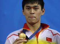 China's Sun Yang poses with his gold medal after winning the men's 1500m freestyle final swimming competition at the Munhak Park Tae-hwan Aquatics Center  during the 17th Asian Games in Incheon September 26, 2014. REUTERS/Tim Wimborne