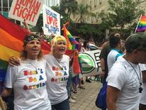 Same-sex marriage supporters chant outside the Miami-Dade County courthouse following a hearing seeking to strike down the state's de facto ban on gay marriage and order it to recognize same-sex marriage, in Miami, Florida July 2, 2014.  Same-sex marriages could begin in Florida in early January after the U.S. Court of Appeals for the 11th Circuit on Wednesday declined to extend a stay issued by a federal judge who struck down the state's ban on gay weddings. REUTERS/Zachary Fagenson
