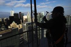 """A construction worker uses a hammer as he works on the """"ICE Condominiums"""" development site by Cadillac Fairview and Lanterra Developments in Toronto December 14, 2012.  REUTERS/Mark Blinch"""