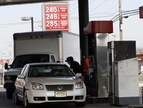 Vehicles wait in line at a gas station in Turnersville, New Jersey December 4, 2014. REUTERS/Tom Mihalek