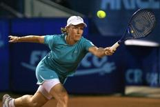 Tennis great Martina Navratilova of the U.S. returns a shot to Monica Seles during their demonstrative match at the BCR Open Romania tennis tournament in Bucharest in this September 16, 2007 file photo. REUTERS/Mihai Barbu/Files