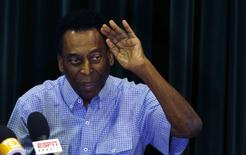 Brazilian soccer legend Pele attends a news conference in Sao Paulo, December 9, 2014.  REUTERS/Paulo Whitaker