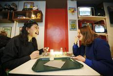 "Customers Sydney Fortune (L) and Julia Lessere eat cereal at the ""Cereal Killer Cafe"" in east London December 10, 2014. REUTERS/Luke MacGregor"