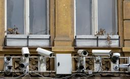 Surveillance cameras are seen on a building in Prague May 22, 2012. REUTERS/David W Cerny