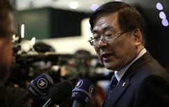 Yang-ho Cho, PyeongChang 2018 Winter Olympic bid Chairman delivers a statement after their presentation to the International Olympic Committee members at the Olympic Museum in Lausanne in this file photo taken on May 18, 2011. REUTERS/Denis Balibouse