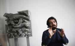 Portuguese artist Alexandre Farto, known by the tag name VHILS, holds a interview at his study in Lisbon December 4, 2014.   REUTERS/Rafael Marchante