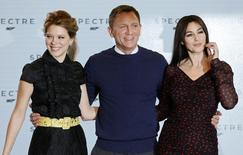 """Actors Lea Seydoux, Daniel Craig and Monica Bellucci (L-R) pose on stage during an event to mark the start of production for the new James Bond film """"Spectre"""", at Pinewood Studios in Iver Heath, southern England December 4, 2014.       REUTERS/Stefan Wermuth"""